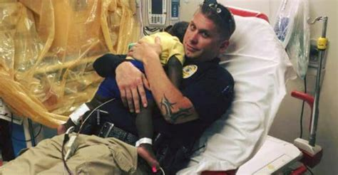 Picture captures a police officer comforting a scared