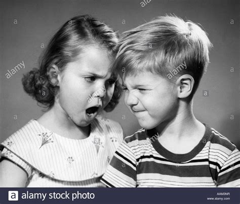 1950s BOY AND GIRL ARGUING HEAD TO HEAD Stock Photo