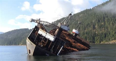 Dramatic video shows barge nearly capsizing to unload logs